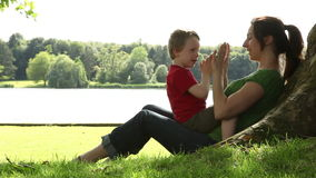 Mum and son playing under a tree
