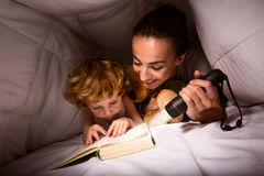 Mum and son reading exciting story Royalty Free Stock Image