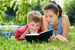 Mum and the son reads Royalty Free Stock Image