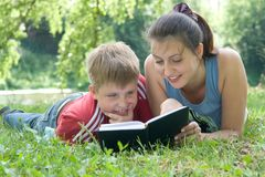 Mum and the son reads Stock Image
