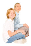 Mum and son sat on the floor smiling isolated on white backgroun Royalty Free Stock Photos