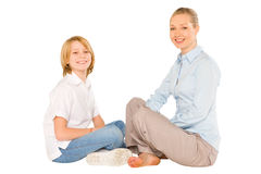 Mum and son sat on the floor smiling isolated on white backgroun Royalty Free Stock Image