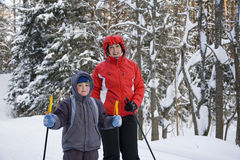 Mum with the son on skis Royalty Free Stock Image