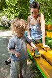Mum and son together in park Stock Photo
