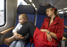 Mum and the son travel. In a train royalty free stock images
