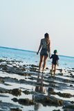Mum and the son walk on a coast Stock Photos
