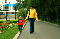 Mum and the son on walk in park Royalty Free Stock Photos