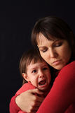 Mum sorry for the girl crying. On a black background Royalty Free Stock Photo