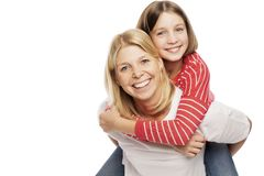 Mum with a teenager daughter laughing and hugging, isolated on white background. Tenderness and love stock photos