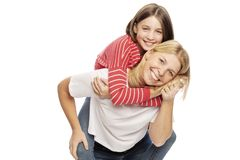 Mum with a teenager daughter laughing and hugging, isolated on white background royalty free stock images