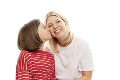 Mum with a teenager daughter laughing and hugging, isolated on white background. Tenderness and love royalty free stock images