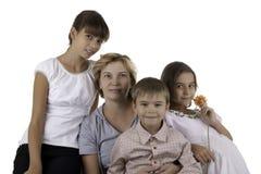 Mum with three children. Isolated Royalty Free Stock Photo