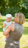 Mum walks with the child Stock Images