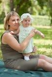 Mum walks with the child i Stock Photography