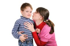 Mum wants to kiss the small son Stock Photo