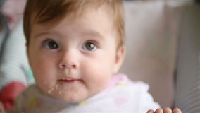 Mum wipes face of a small child stock footage