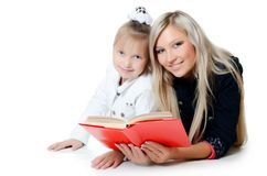 Mum With Daughter Read The Book Stock Images