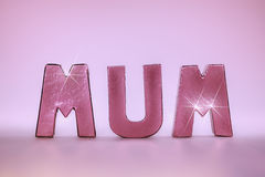 Mum word in glamtastic pink rose gold letters Royalty Free Stock Photography