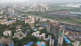 New infrastructure developing suburbs of Mumbai. Mumbai is financial capital of India. New tall high rise apartment buildings are developing in far suburbs in Royalty Free Stock Photography