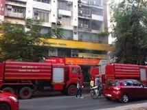 Mumbai Fire Brigade dousing a fire. At ING Vyasya Bank in Mumbai, India stock photography
