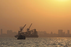 Mumbai harbor at sunset Stock Photography