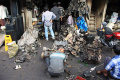 Mumbai/India - 22/11/14 - Car Breaker demolishing part of an engine in the Thieves Market, Mumbai Stock Photos