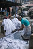 Dhobi Ghat in Mumbai, Maharashtra, India. MUMBAI, INDIA - JANUARY 12, 2016: Indian workers washing clothes at Dhobi Ghat, a well know open air laundromat in Stock Photos