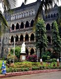 Mumbai High court and gardens. Mumbai, India - January 2017:Queen Victoria`s statue outside the High court Stock Photo