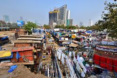 Dhobi Ghat and the modern skyline. Mumbai, India - January 2017:Washing at the Dhobi Ghat Royalty Free Stock Photo