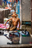 MUMBAI, INDIA - JULY 7, 2016 : Child of India - portrait of India young small girl child ready to take a bath Stock Images