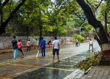 Boys playing cricket on streets at Ballard Estate, South Mumbai stock photo