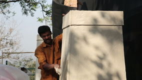 MUMBAI, INDIA - MARCH 2013: Two Indian masons at work stock video footage