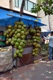 Man sells coconuts. MUMBAI, INDIA - MAY 18, 2013 - Man sells coconuts   in Mumbai, India Royalty Free Stock Photo