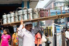 Mumbai, India, 20 november 2018 / The famous Dabbawala lunchbox service in Churchgate Railway Station; operators dressed in white stock photography