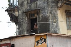 Mumbai, India, 20 november 2018 / Old man looking out a window stock photo