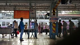 Mumbai local train station with passengers stock photography