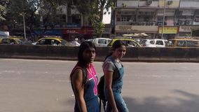 Mumbai ,Maharashtra /India . january 20, 2019 indian police patrolling the city. while people moving on with their busy daily rout stock footage