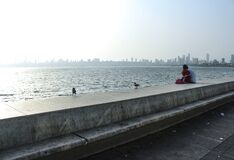 Free Mumbai, Maharashtra / India- May 31 2020: A Couple Sitting At Marine Drive Near Indian Ocean, Watching Sunset Together Stock Images - 184984184