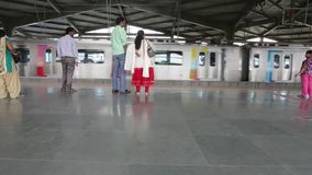 Mumbai Metro train at station and commuters waiting, entering the metro. MUMBAI, INDIA:August 29th 2014:Mumbai Metro train at station and commuters waiting stock video