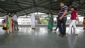 Mumbai Metro train station and commuters waiting, entering the metro. MUMBAI, INDIA:August 29th 2014:Mumbai Metro train station and commuters waiting, entering stock video