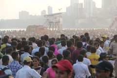 Mumbai people gather on marine drive shore. Thousand of residents of mumbai come to sea coast near girgaon chaupati for immersion of lord ganesh idol immersion royalty free stock photos