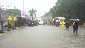 Mumbai rains. Mumbai traffic police personnel direct traffic at a waterlogged street after heavy rains in Mumbai, India on July 10, 2018 stock video footage