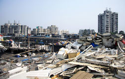 Mumbai Rooftop Slums piled high with rubbish Stock Images