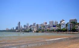 Mumbai Skyline. Seafront Mumbai India skyline over blue sky stock images
