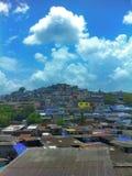 Mumbai Slums on a hillside. Slums dot the hillside of Chandivali in Mumbai India Stock Image