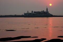 Mumbai sunset. Sunset over mosque in Mumbai royalty free stock photos