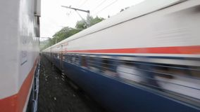 Mumbai to Pune train journey in rainy days in hill area. Royalty Free Stock Photo