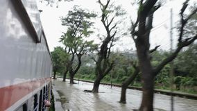 Mumbai to Pune train journey in rainy days in hill area, train entering station Khandala. Stock Image