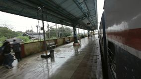 Mumbai to Pune train journey in rainy days in hill area, train leaving station Lonavala . Royalty Free Stock Photo