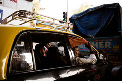 Mumbai Traffic Jam. MUMBAI, INDIA - November 5 2017: A taxi driver and his passenger wait in heavy traffic in downtown Mumbai, India Royalty Free Stock Photos